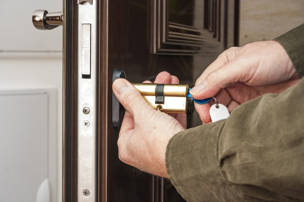 homeguide locksmith rekeying a front door lock on house 1